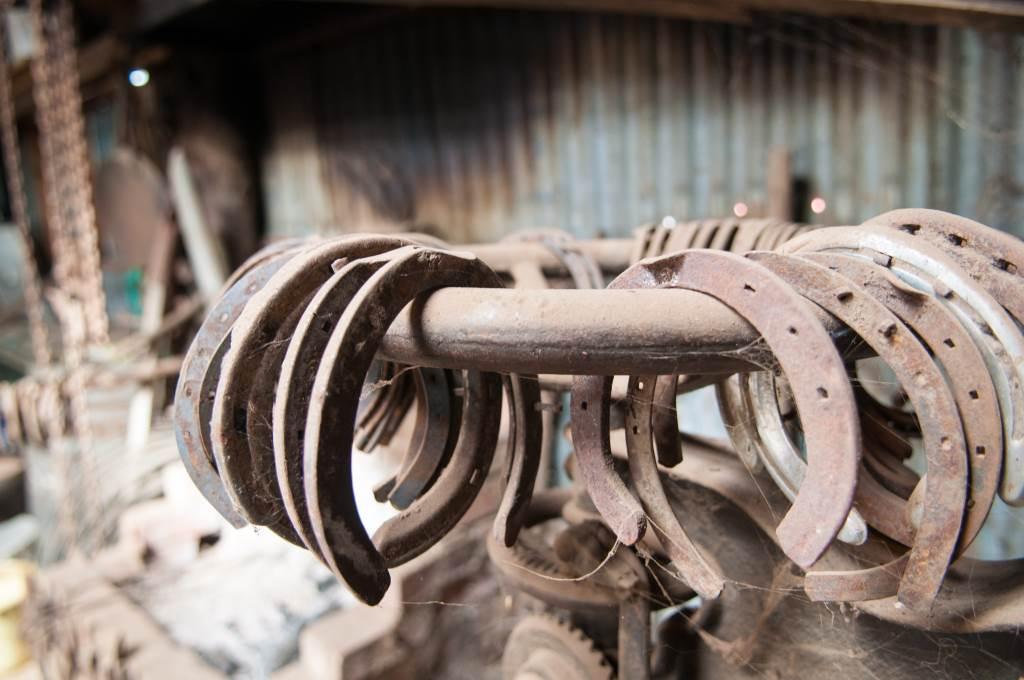 set of horse shoes in workshop for barn flooring