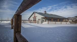 a horse barn in the snow